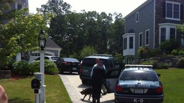 A K9 crew arrives to the home of Aaron Hernandez on Saturday, June 22, 2013.