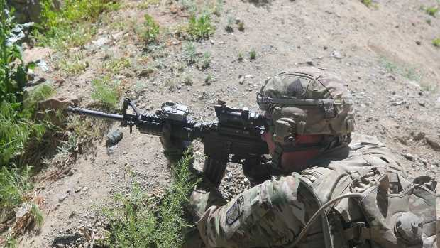 U.S. Army Sgt. Corey Garver, with Baker Company, 1st Battalion, 506th Infantry Regiment, 4th Brigade Combat Team, 101st Airborne Division, provides security as Soldiers with Baker Company and Afghan National Army soldiers clear a village in Paktia province, Afghanistan, May 29, 2013