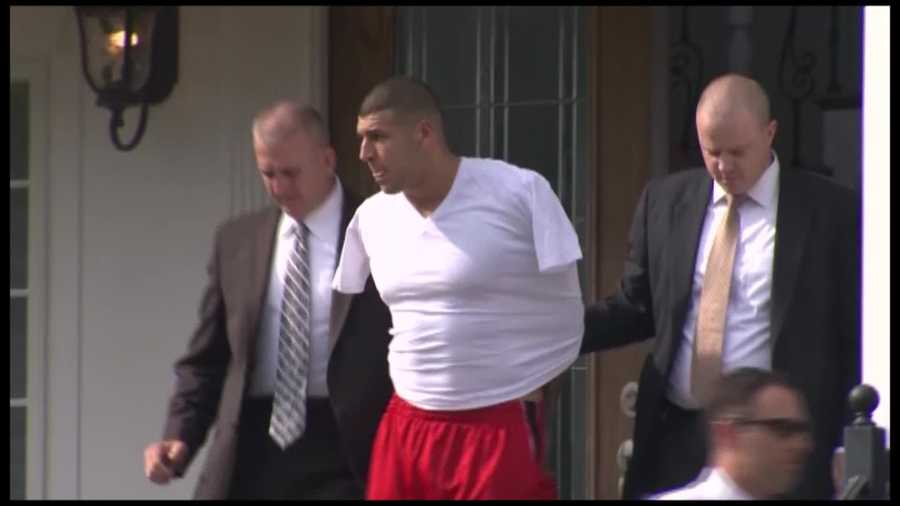 June 26: Hernandez is taken from his home in handcuffs and driven away in a police cruiser.