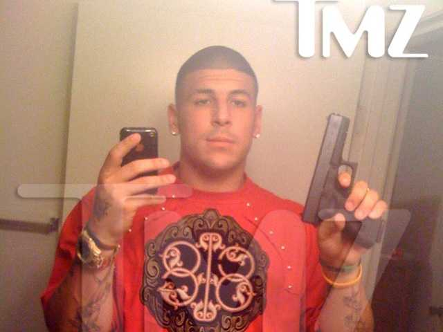 This photo, courtesy TMZSports.com , shows Hernandez holding a gun which prosecutors said was similar to the one used in the killing of Odin Lloyd.