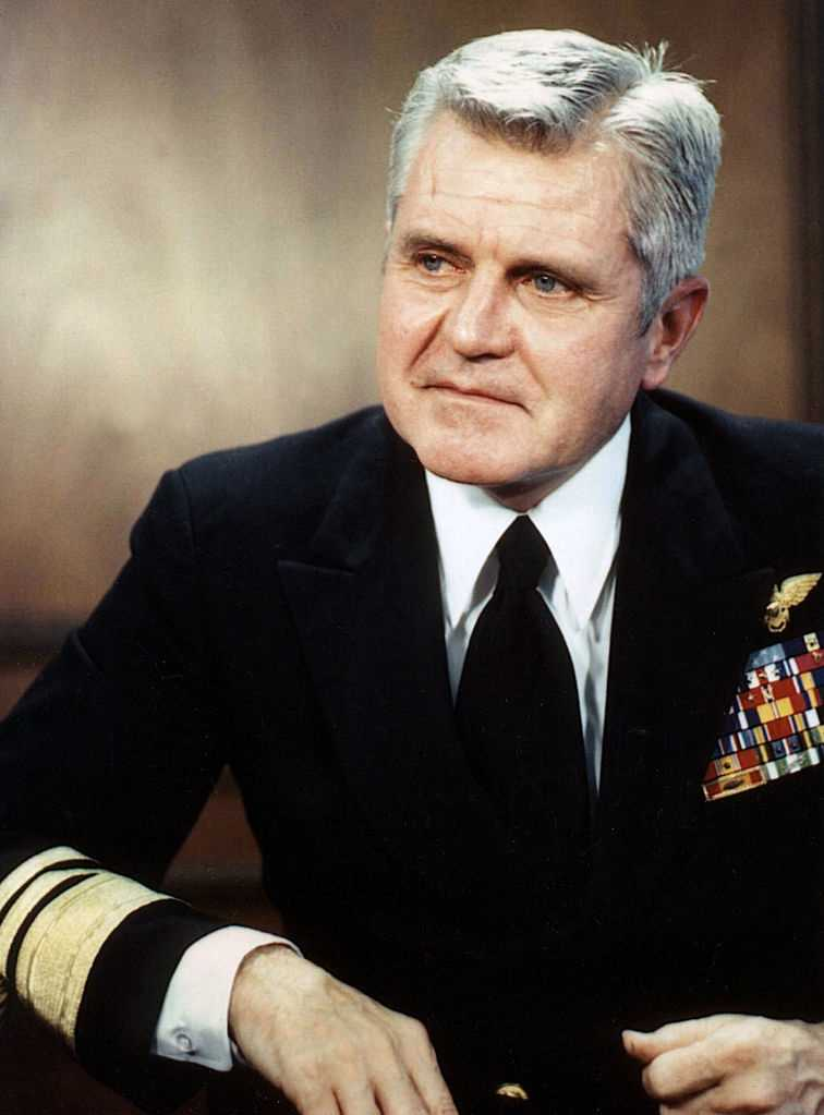 "2005: Vice Admiral James Stockdale, one of the most highly decorated officers in the history of the United States Navy and Ross Perot's vice presidential running mate in 1992, dies of Alzheimer's disease at age 81 in Coronado, California. Stockdale, who was awarded 26 personal combat decorations, including the Medal of Honor and four Silver Stars, was the highest-ranking naval officer held as a prisoner of war in Vietnam. He is perhaps best remembered today for introducing himself to the country during the 1992 vice presidential debate by joking ""Who am I? Why am I here?"""