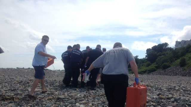 Emergency crews tend to the victim on Winthrop Beach