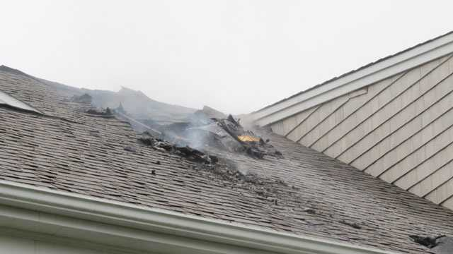 The Dennis home where a lightning strike caused a fire and made a hole in the roof.