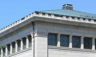 This town is also the home of the first free public library. Where are we?
