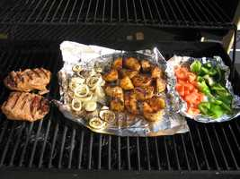 Partially cook meat and fish in a microwave for 60 to 90 seconds on high before grilling and then discard the juices. This will lower cooking time and reduce risk of cause smoke flare-ups.