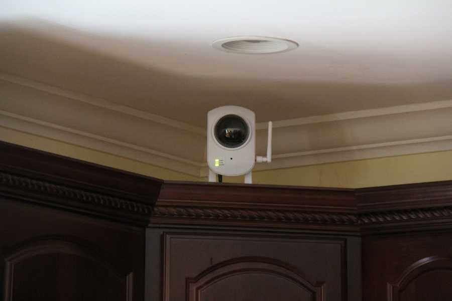 Strategically placed cameras allow a user to monitor activity inside their home while they are away at work, or on vacation.
