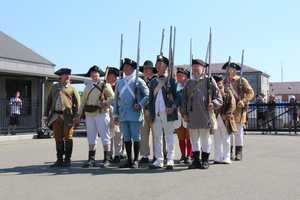 The tour included a 21-gun salute off Fort Independence on Castle Island in South Boston.