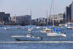 Dozens of boats in Boston Harbor for the Fourth of July.