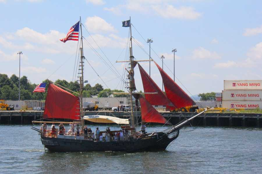 "Dozens of boats, including this historic looking pirate ship were located around ""Old Ironsides"""