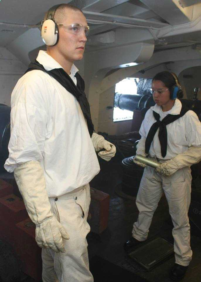 On the lower level, crew wear headphones to protect them from the very loud noise from each gun that fires.