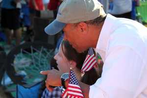 Gov. Deval Patrick points something out to a young girl attending the concert.