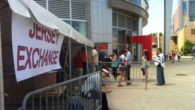 New England Patriots fans line up outside the ProSho at Gillette Stadium on Saturday, July 6, 2013, to exchange Aaron Hernandez jerseys.