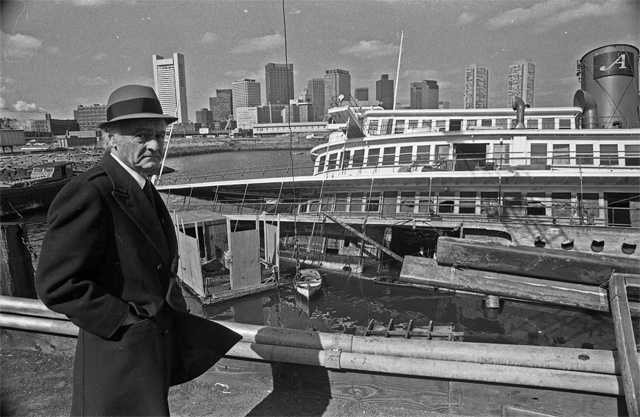 "Anthony Athanas standing alongside ""The Peter Stuyvesant,"" which was docked next to Pier 4, after it overturned during the ""Blizzard of 78.""  Pier 4 was scheduled to close in August 2013."