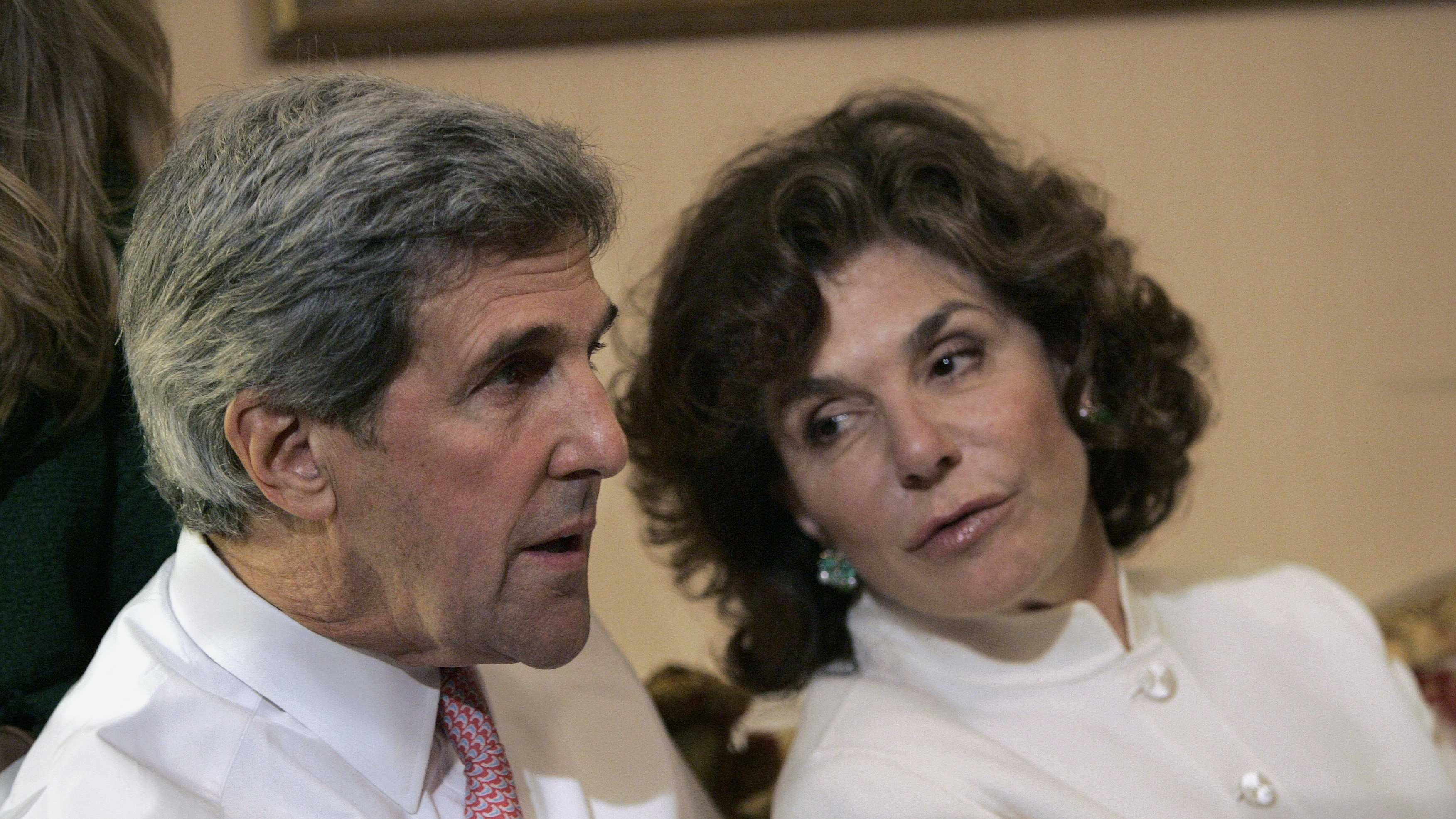 Sen. John Kerry, D-Mass, left, talks with his wife Teresa Heinz Kerry while watching election results at a hotel in Boston, Tuesday, Nov. 4, 2008,