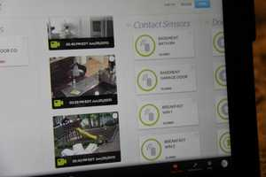 People can remotely manage the security devices and view live video from the installed cameras.