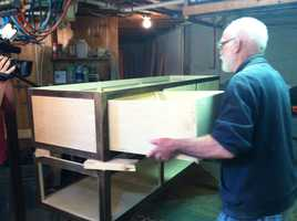 Lakin runs a website and lectures on affordable funeral alternatives, but his specialty is designing coffins and building them in his own shop.