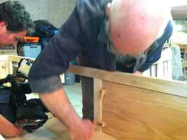 Lakin builds relatively inexpensive coffins that serve a real function until needed.