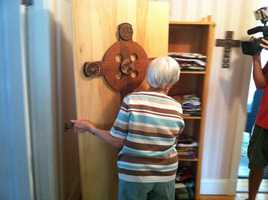 Virginia Landry, one of Lakin's customers, does not shy away from showing off her custom-made coffin.