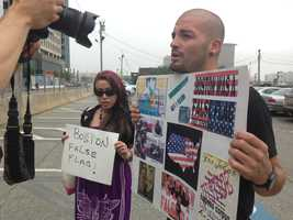 A Tsarnaev supporter holds a sign up for media to see outside the federal courthouse.
