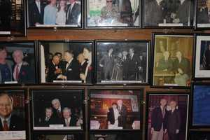 Photographs of celebrities who had been to Anthony's Pier 4 lined the wooden walls of the entrance