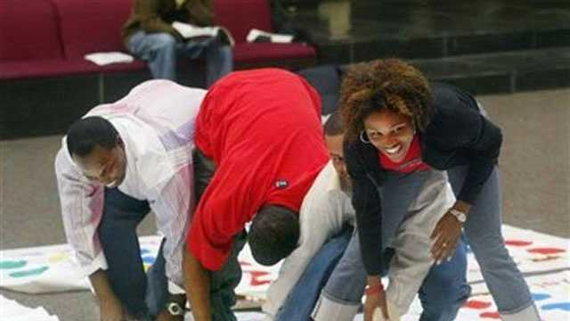 FILE - Twister game being played in Edwardsville, Ill. on Sept. 22, 2004.