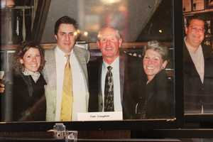 Head Coach of the New York Giants, Tom Coughlin, poses for a picture with Michael Athanas. This photograph was hanging on the wall in the lobby of the restaurant.