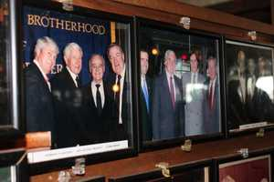 Photographs of celebrities who had visited Anthony's Pier 4 lined the walls of the restaurant's lobby