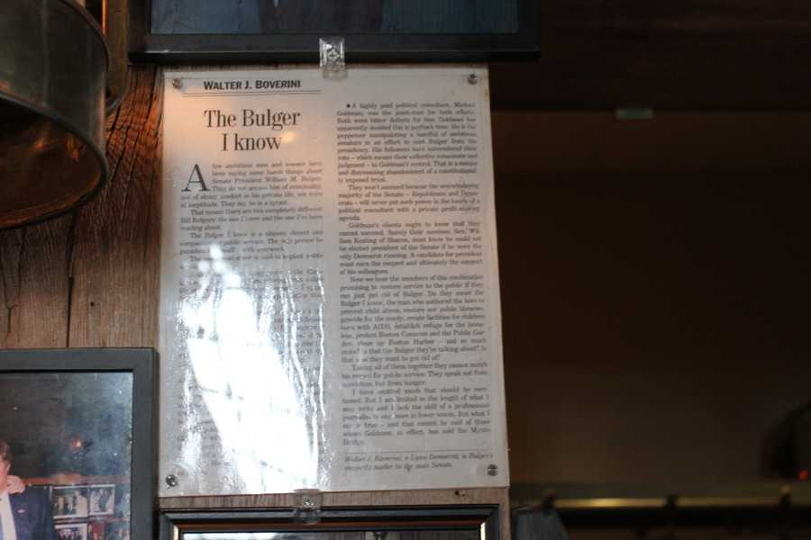 """An article entitled, """"The Bulger I Know,"""" by Walter J. Boverini, about mobster James """"Whitey"""" Bulger, hung on the wall right next to the coatroom at the entrance to the building"""