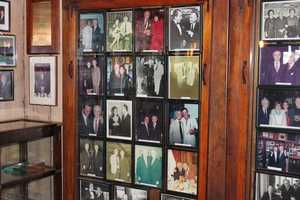 Photographs of celebrities who had visited the restaurant lined the walls of the lobby