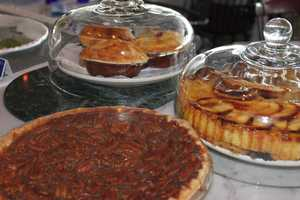 Some of the desserts were displayed on a table in the front section of the dining room