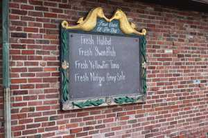 A list of the fresh catches of the day hung outside the restaurant entrance