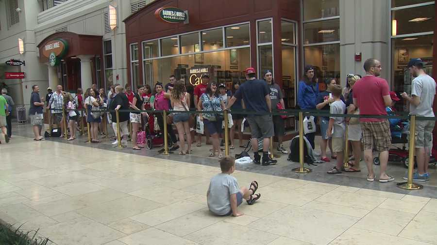 Hundreds of fans waited outside the store to meet the Patriots star.