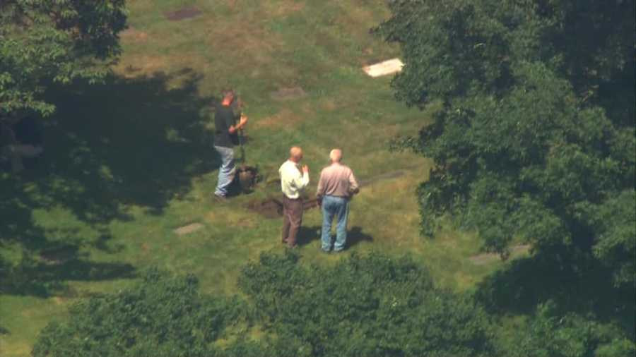 Workers spent a few minutes digging into the plot where DeSalvo is buried.
