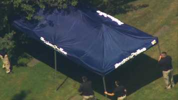 A Boston Police tent was setup to shield media overhead from seeing part of the investigation.