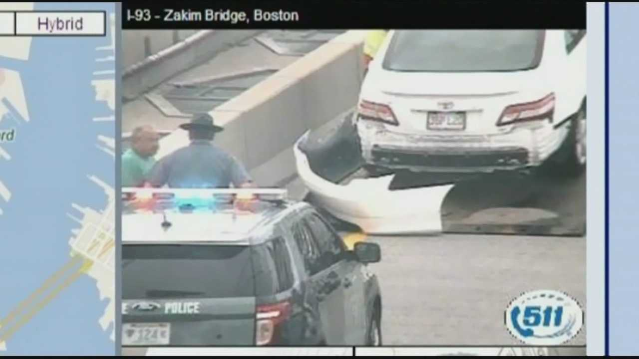 A massive-sized American Flag came tumbling down from Boston's Zakim Bridge Friday, causing one driver to crash into another.