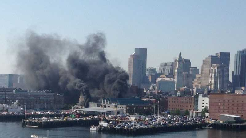 A fire inside a three-story warehouse at the Boston Coast Guard station caused smoke to fill the nearby neighborhood.