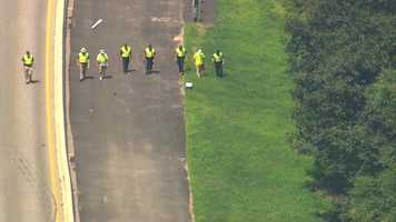 Investigators walked along the left side of Interstate 95 in an investigation tied to the Bristol County District Attorney's Office.