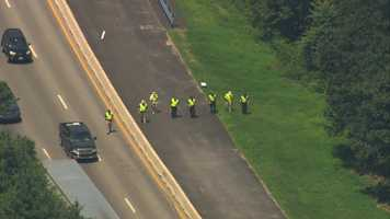 Police blocked off one lane of traffic as investigators searched the highway.