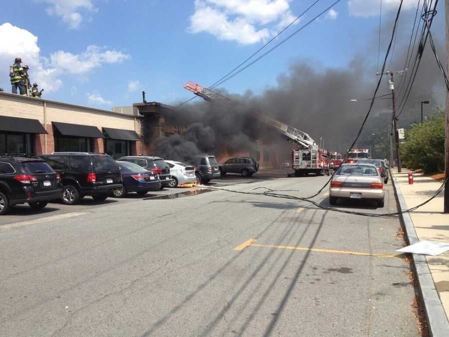 The wire came down and fire spread to two cars and the building.