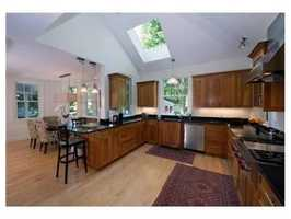 The coveted pondside Victorian is on over half an acre!