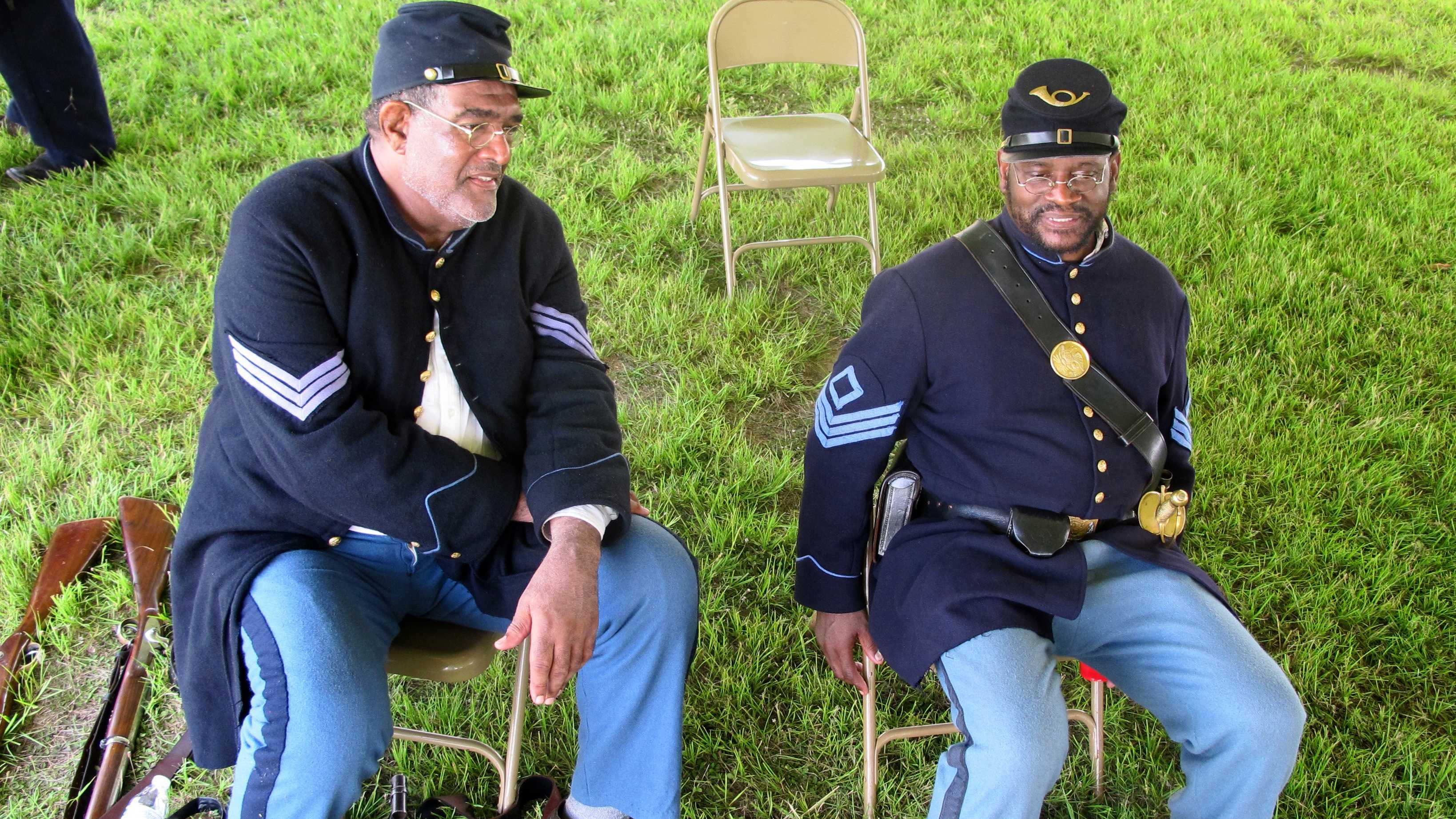 "Walter Sanderson of Upper Marlboro, Md., left, and Louis Carter of Richmond, Va., re-enactors portraying members of the 54th Massachusetts Volunteer Infantry, sit in an encampment at Fort Moultrie on Sullivans Island, S.C., on Thursday, July 18, 2013. The re-enactors gathered to commemorate the 150th anniversary of the famed Civil War attack by the 54th Massachusetts Volunteer Infantry in a fight commemorated in the film ""Glory."""