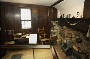 A table, rocking chair, cooking utensils and a fireplace are seen in the kitchen of the home of Paul Revere, in Boston's North End, Feb. 7, 2002. The historic structure, home to one of America's most well-known patriotic figures, is still furnished with original colonial style furniture and decorations.