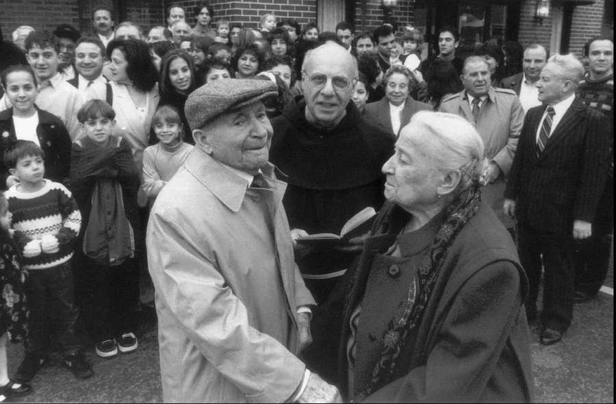 Angelo Martignetti, 94, left, and his wife Michelina, 92, are seen Dec. 13, 1997 in thee North End, as they celebrate a renewal of their wedding vows prior to their 75th wedding anniversary on New Year's Eve. The couple, who were married in 1922 in Montefalcione, Italy, and moved to Boston in the mid-1950s, were honored with a large family party.