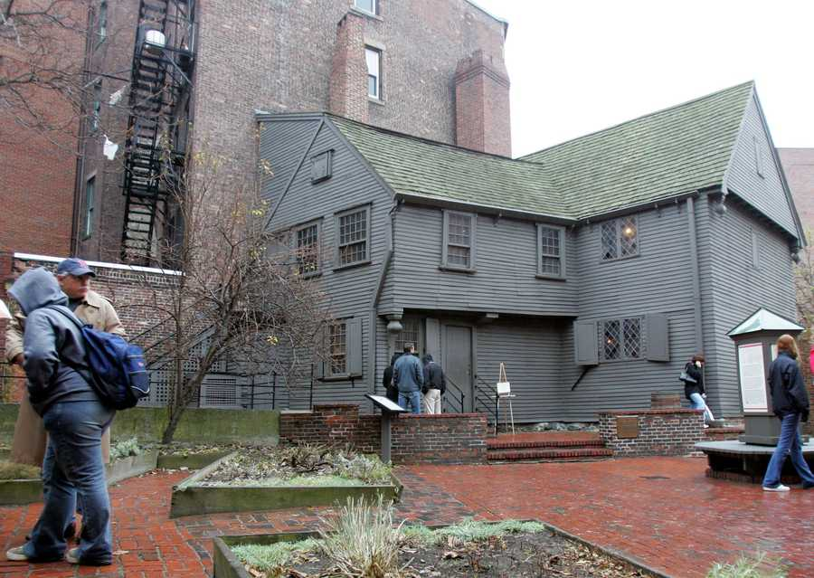 Pedestrians walk pass the exterior of Paul Revere's home in Boston's North End, Feb. 7, 2002. The historic structure, home to one of America's most well-known patriotic figures, is still furnished with original colonial style furniture and decorations.