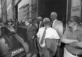 Michele Angiulo, center, and his brothers, Francesco, left, and Donato, right, leave a building in Boston's North End after a jury in their racketeering trial was given a tour of the headquarters of their alleged criminal organization, July 9, 1985.