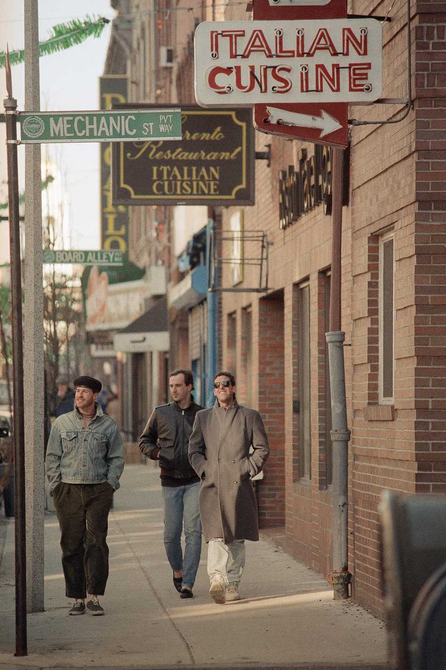 Pedestrians make their way January 3, 1989 along Hanover Street in the Historic North End, which a study said was changing from an Italian-American, blue-collar working class population to elderly men and women and white-collar professionals.