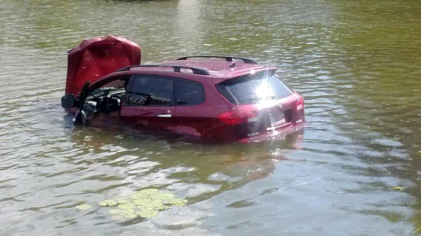 Car into Pond Millbury 072913.jpg