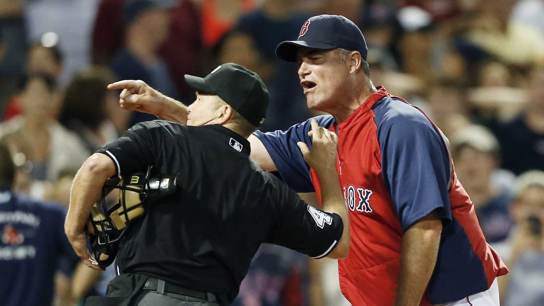 Home plate umpire Jerry Meals, left, ejects Boston Red Sox manager John Farrell in the eighth inning of a baseball game against the Tampa Bay Rays in Boston, Monday, July 29, 2013. The Rays won 2-1.