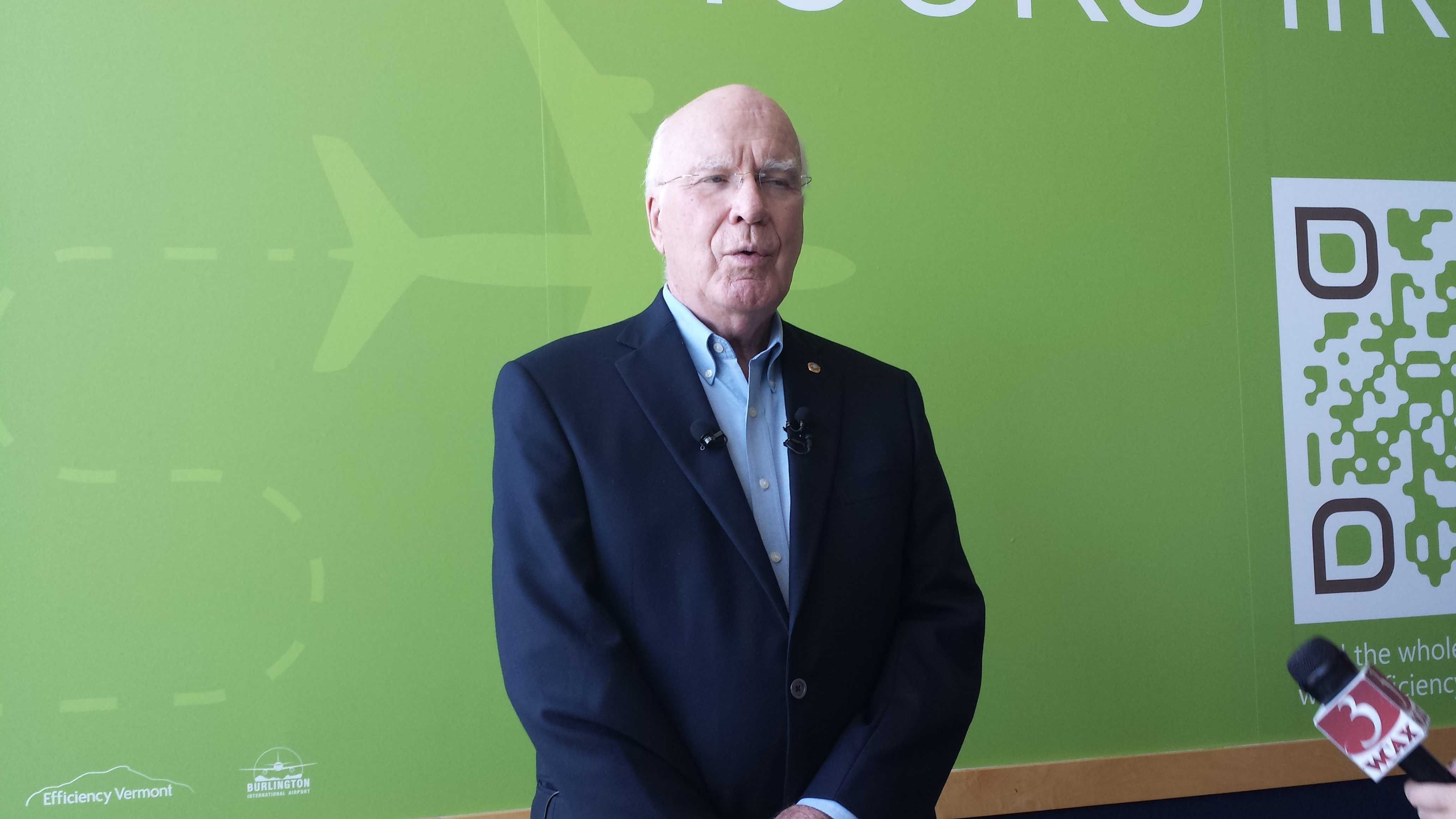 Sen. Patrick Leahy speaks with reporters Friday after landing at Burlington International Airport.