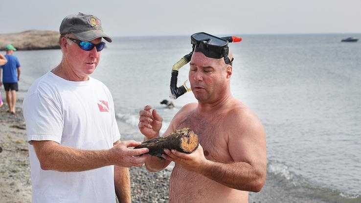 Diver Dan Chiasson, of Scituate discovered two wrecked barges off Minot Beach in Scituate.Tom Mulloy, also a diver from Scituate, helps him identify the pieces,Saturday, July 20,2013.